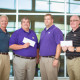 Self Regional Healthcare's Sports Medicine Center staff present Emerald High School and Greenwood High School athletic departments with checks totaling $5,450.