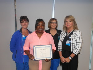 Pictured (from left): Janet Williams, Frank Spoone Memorial Respiratory Therapy scholarship committee member; Senchia Wilson, scholarship recipient; Martha Huddelson, committee member; Sherri Gordon, director of respiratory therapy services at Self Regional Healthcare.