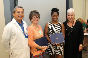 Members of the Charlotte Blackwell Memorial Nursing Scholarship committee present certificates to 2014 scholarship recipients, Kadeidra Chandler of Edgefield and Mona McKinney of Greenwood. Pictured from left are John Paguntalan, Mona McKinney, Kadeidra Chandler and Kaye Brock. (Not pictured is scholarship winner Ashley Edwards of Saluda.)