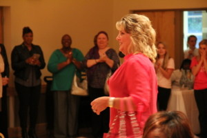 """Angela Winchester walks the pink runway from the 2013 Pretty in Pink celebration. Ms. Winchester is a breast cancer survivor who works in Imaging Services at Self Regional and says she uses each day """"to be a voice for breast cancer survival."""""""