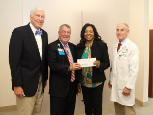 United Center for Community Care: (From Left): Self Regional Board of Trustees Chairman Len Bornemann is joined by Self Regional CEO Jim Pfeiffer, Deborah Parks, Executive Director of the United Center for Community Care, and Cardiologist Dr. Ennis James, who serves on the Community Outreach Committee.