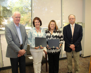 Pictured from left: retired Self Regional executive John Heydel, scholarship recipients Christy Fain and Julie Culbertson, and Director of Respiratory Care Services, Ron Deeder.