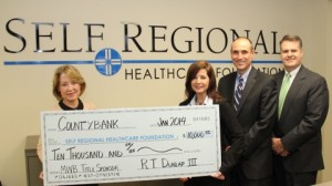 The Self Regional Healthcare Foundation's 2014 Mid-Winter Ball co-chair, Jane Dean (left), recently accepted a $10,000 check from Countybank representatives, Lynn Turner and David Tompkins and Greenwood Capital and Associate's John Wiseman.