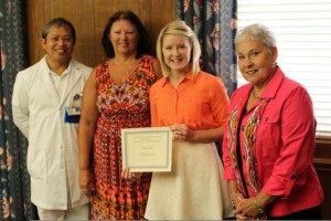 Members of the Charlotte Blackwell Memorial Nursing Scholarship committee present a certificate to 2013 scholarship recipient, April Payton. Pictured from left are John Paguntalan, Jackie Thornton, Ms. Payton and Kaye Brock. Not present is scholarship recipient Brandon Scott.