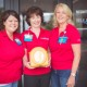 Self Regional Heart and Vascular Team with one of the AED devices to be awarded to a local organization or business.