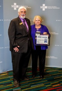 Infection Prevention Coordinator Nancy Lumley from Self Regional Healthcare is presented a Zero Harm Award from the South Carolina Hospital Association's Dr. Rick Foster at a recent meeting in Columbia.