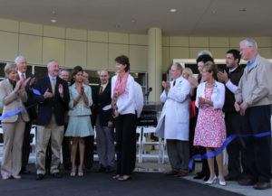 Former patient Lynn Johnson cuts the ribbon for the new consolidated Self Regional Healthcare Cancer Center.