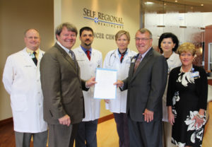 Pictured from left are: Dr. John Funke, radiation oncologist; Rep. Pinson; Dr. Brian Hunis, medical oncologist; Dr. Joanna Sadurski, medical oncologist; Pfeiffer; Dr. Lena Vician, medical oncologist; and Kendra Keeney, Administrative Director of Cardiovascular and Cancer Services at Self Regional.