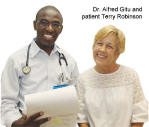 Terry Robinson (right), a patient at the Greater Greenwood United Ministry Free Clinic, said she owes her life to volunteer caregivers Dr. Alfred Gitu (left) and others. She had a tumor removed from her esophagus after a 2006 visit to the clinic. An annual grant from Self Regional Healthcare, along with free office space in the hospital-owned and -maintained building, helps make the ministry possible.