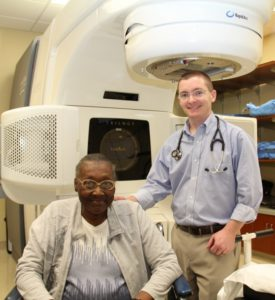 Gladys Roundtree, the first patient to receive stereotactic radiation therapy at the Self Regional Healthcare Cancer Center, and her radiation oncologist, Dr. Clint Wood.