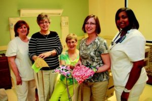 Self Regional Nurse manager Louise Cox thanks Sewing Guild members Linda Goldstein, Sue McFarland and Evie Galloway, with surgical nurse Derquis Mitchell.