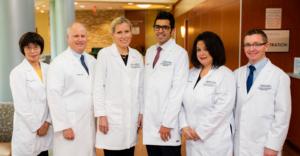 Photo showing the six health providers of Self Regional Healthcare Cancer Center in Greenwood SC: Ruiling Yuan MD, John Funke III MD, Joanna M. Sadurski MD, Ahmad Rahal MD, Cathy Pasco MD, and E. Clint Wood MD.